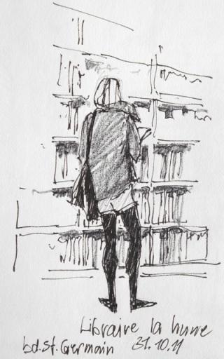 """Wolfgang Krisai: Ein """"Pariser Fräulein"""" in der Buchhandlung La Hune. - In diser Buchhandlung, die inzwischen einen neuen Standort hat, kaufte mir meine Frau die Bücher."""